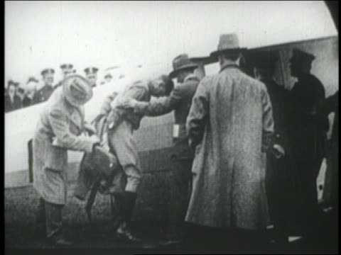 charles lindbergh putting on flying outfit on airfield in ny - 1927 stock videos & royalty-free footage