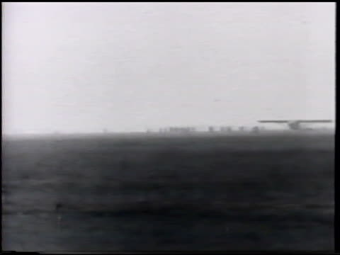stockvideo's en b-roll-footage met charles lindbergh 'spirit of st louis' monoplane aircraft taxiing in fog on roosevelt field long island new york couple of partial take offs in... - 1927