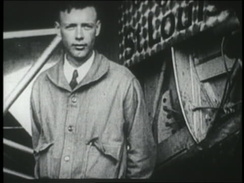 stockvideo's en b-roll-footage met charles lindbergh standing by the spirit of st louis airplane / ny - 1927