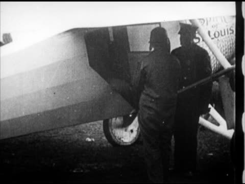 charles lindbergh standing next to 'spirit of st louis' monoplane aircraft getting into airplane man turning propeller lindbergh waving plane taxiing... - 1927 stock videos & royalty-free footage