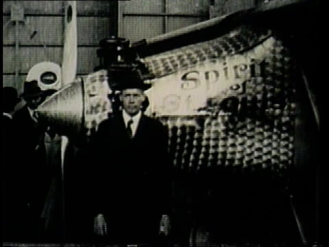 charles lindbergh stands beside his plane, the spirit of st. louis. - charles lindbergh stock videos & royalty-free footage
