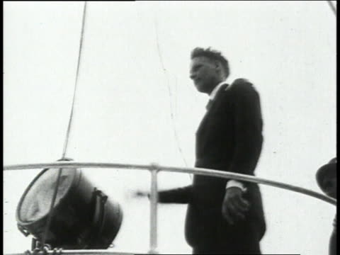 charles lindbergh waves at ships in the harbor a ship sprays a fountain of water / new york new york united states - 1927 stock videos and b-roll footage