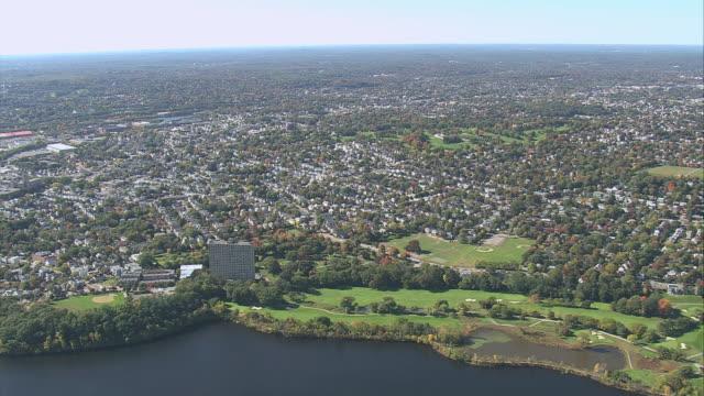 aerial charles river running through suburban metropolitan area / boston, massachusetts, united states - river charles stock videos & royalty-free footage