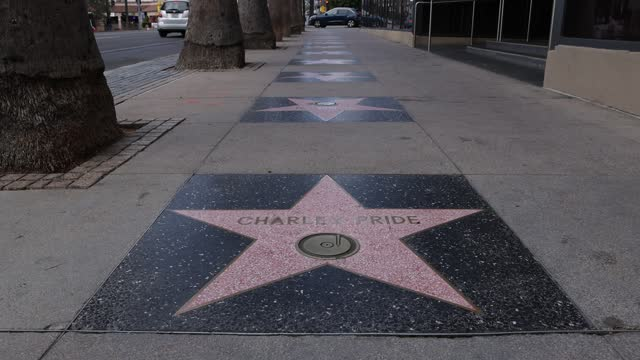 charley pride's star on the hollywood walk of fame is seen on december 13, 2020 in hollywood, california. pride died from complications of covid-19... - walk of fame stock videos & royalty-free footage