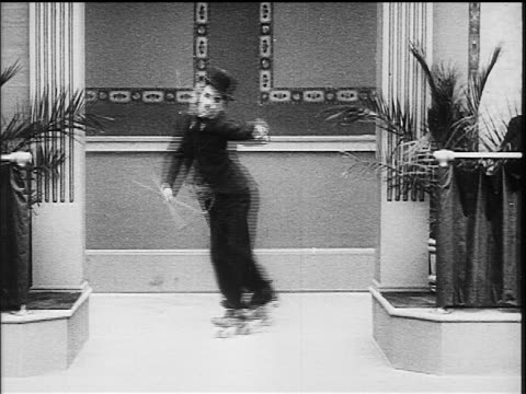 charlie chaplin as little tramp roller skating on one foot - 1916 stock videos & royalty-free footage