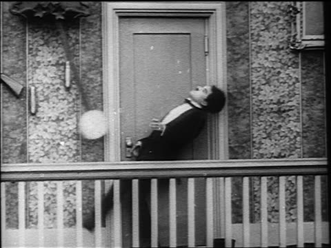 charlie chaplin ducking entering doorway after being knocked over by swinging pendulum - 1916 stock videos & royalty-free footage