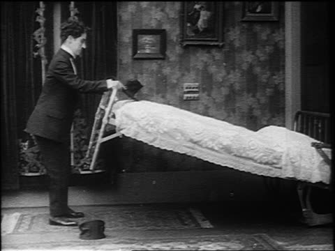 charlie chaplin getting knocked over bounced by bouncing murphy bed in room - 1916 stock videos & royalty-free footage
