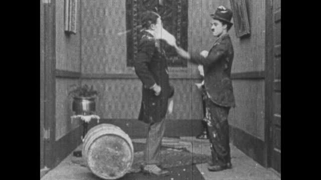 1915 Charlie Chaplin has slap fight with man using wallpaper brush as a weapon