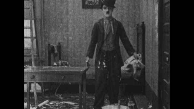 1915 charlie chaplin makes a mess trying to hang wallpaper - glue stock videos and b-roll footage
