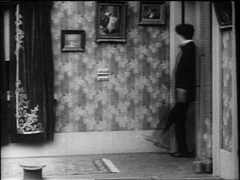 charlie chaplin pushing button on wall getting trapped in spinning murphy bed - 1916 stock videos & royalty-free footage