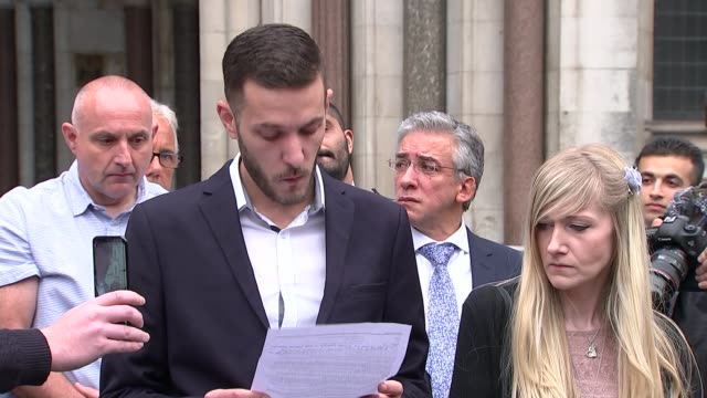 Parents end legal fight over treatment ENGLAND London High Court EXT Connie Yates and Chris Gard towards from court/ Chris Gard statement outside...