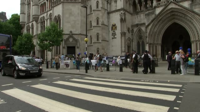 parents walk out of high court hearing gvs high court / royal courts of justice - court room stock videos and b-roll footage