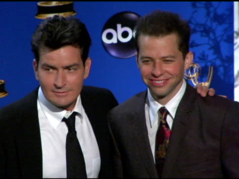 charlie sheen and jon cryer presenters of outstanding lead actor in a comedy series at the 2004 primetime emmy awards press room at the shrine... - jon cryer stock videos and b-roll footage