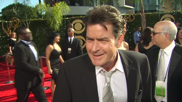 charlie sheen on his nomination experiencing the emmys his suit with a surprising item in his coat pocket at the 61st annual primetime emmy awards... - annual primetime emmy awards stock-videos und b-roll-filmmaterial