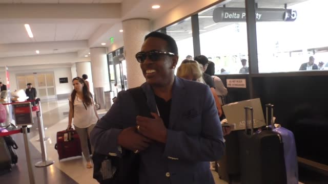 INTERVIEW Charlie Wilson talks about his mustach while departing at LAX Airport in Celebrity Sightings in Los Angeles
