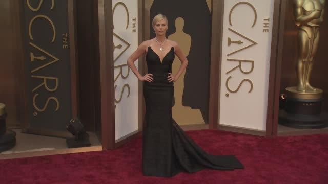 charlize theron 86th annual academy awards arrivals at hollywood highland center on march 02 2014 in hollywood california - academy awards stock videos & royalty-free footage