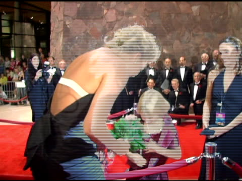 Charlize Theron and Elle Peterson at the 2006 Palm Springs International Film Festival Gala at Palm Springs Convention Center in Palm Springs...