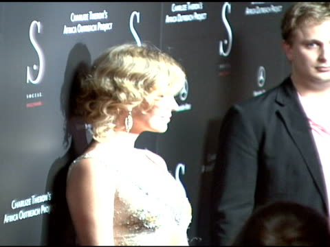 charlize theron and stuart townsend at the grand opening of social hollywood hosted by charlize theron at social hollywood in hollywood, california... - スチュワート タウンゼント点の映像素材/bロール