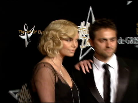 Charlize Theron and Stuart Townsend at the Hollywood Domino Over Oscar Week launch at NULL in Beverly Hills California on February 21 2008
