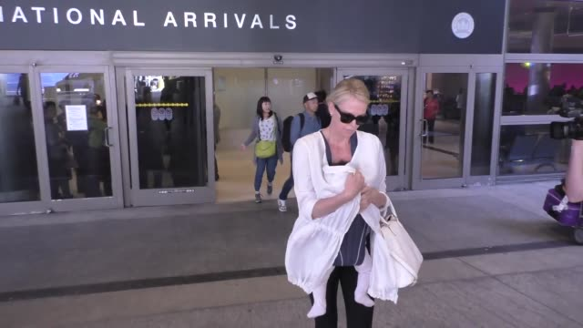 Charlize Theron arriving at LAX Airport in Los Angeles in Celebrity Sightings in Los Angeles