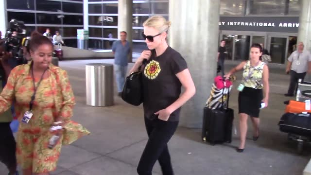 Charlize Theron arriving at LAX Airport on August 28 2015 in Los Angeles California