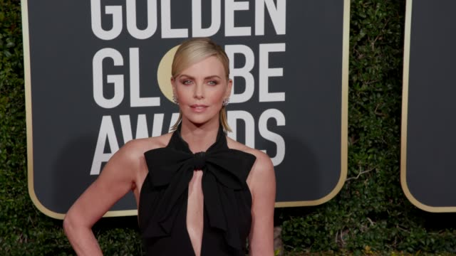 charlize theron at 76th annual golden globe awards arrivals in los angeles ca 1/6/19 4k footage - golden globe awards stock videos & royalty-free footage
