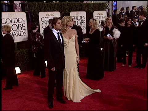 charlize theron at the 2004 golden globe awards at the beverly hilton in beverly hills, california on january 25, 2004. - golden globe awards stock videos & royalty-free footage