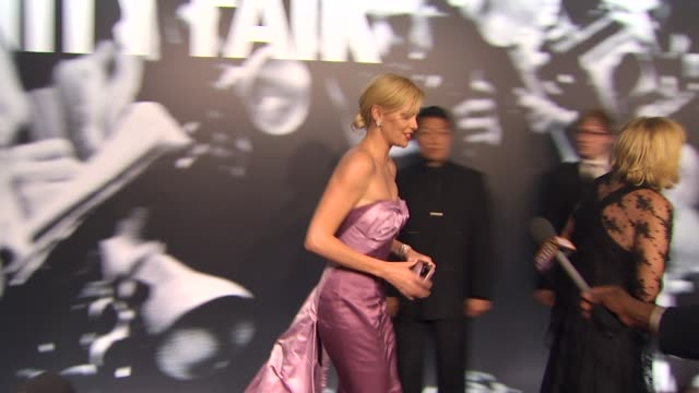 charlize theron at the 2010 vanity fair oscar party hosted by graydon carter at west hollywood ca - graydon carter stock videos and b-roll footage