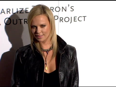 Charlize Theron at the Amped for Africa PreOscar Benefit Hosted by Charlize Theron at Republic Restaurant in Los Angeles California on March 2 2006