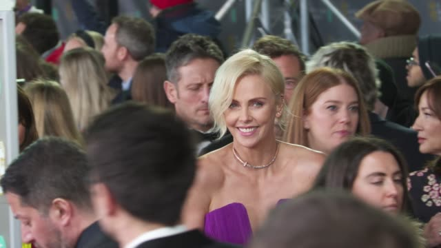 charlize theron attends the ee british academy film awards 2020 red carpet arrivals at royal albert hall on february 2 2020 in london england - british academy film awards stock videos & royalty-free footage