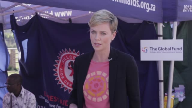 Charlize Theron HIVAIDS campaigner meets with Youth Ambassadors who act as role models for their peers and raise awareness of how to prevent the...