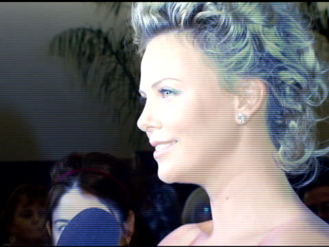 Charlize Theron interviewed by the press at the 2006 Palm Springs International Film Festival Gala at Palm Springs Convention Center in Palm Springs...