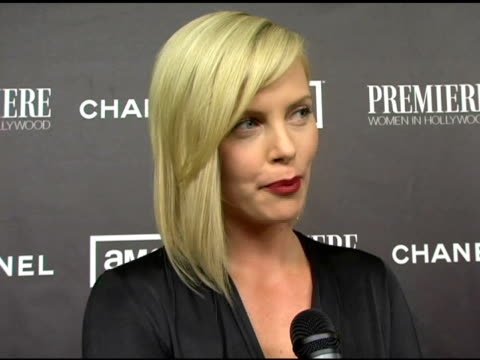 Charlize Theron on her mother being her icon on the qualities that her mother posseses that she most admires at the 12th Annual Premiere Women in...