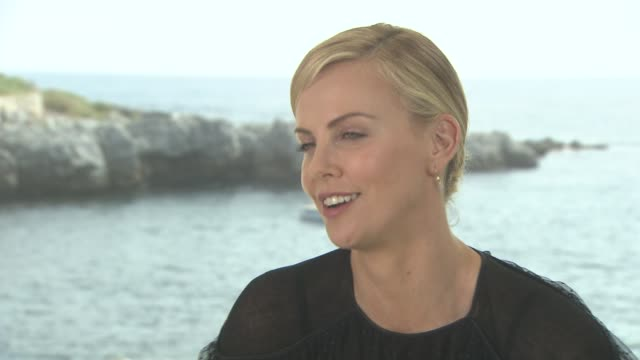 INTERVIEW Charlize Theron on the film being about a woman at 'Mad Max Fury Road' Interviews at Palais des Festivals on May 15 2015 in Cannes France