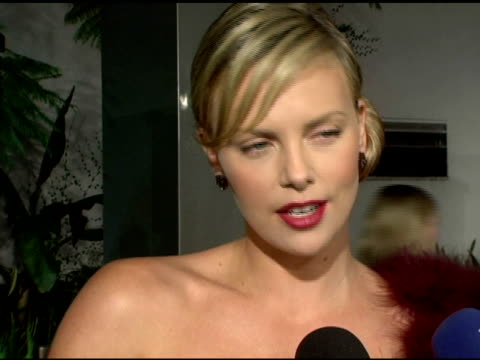 charlize theron on the physical challenges of the role, on her ballet training helping, on playing such a strong character, on how the dark costume... - charlize theron stock videos & royalty-free footage
