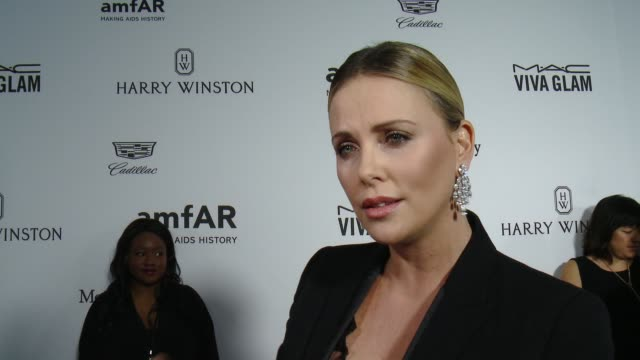 INTERVIEW Charlize Theron on what it means to receive this honor from amfAR at amfAR's Inspiration Gala Los Angeles 2016 in Los Angeles CA