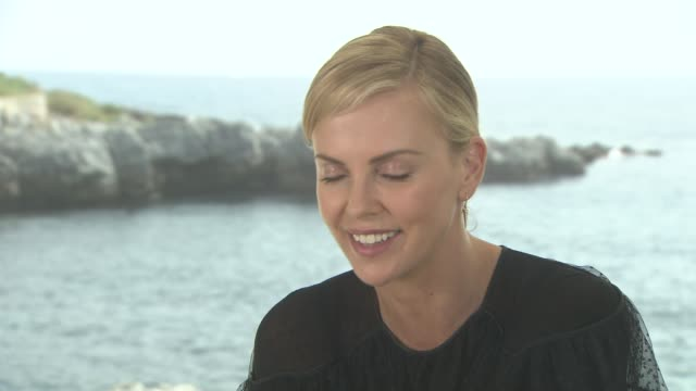 INTERVIEW Charlize Theron on women in films at 'Mad Max Fury Road' Interviews at Palais des Festivals on May 15 2015 in Cannes France
