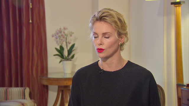 charlize theron says press coverage of her private life is so intrusive that it is comparable to rape the south africanborn actress told sky news... - columnist stock videos & royalty-free footage