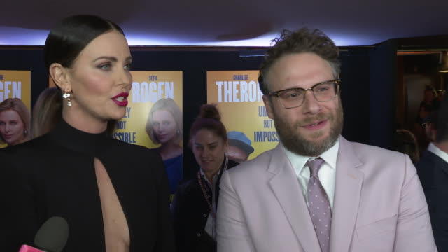 charlize theron, seth rogen on not having date nights, hating each other would make the film better, their age at 'long shot' special screening on... - charlize theron stock videos & royalty-free footage
