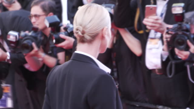 Charlize Theron walking on the red carpet at Cannes Film Festival 2016 during 'The Last Face'