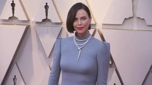 charlize theron walking the red carpet at the 91st annual academy awards at the dolby theater in los angeles, california. - music or celebrities or fashion or film industry or film premiere or youth culture or novelty item or vacations 個影片檔及 b 捲影像