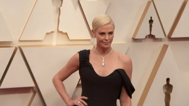 charlize theron walking the red carpet at the 92nd annual academy awards at the dolby theater in los angeles, california. - music or celebrities or fashion or film industry or film premiere or youth culture or novelty item or vacations 個影片檔及 b 捲影像