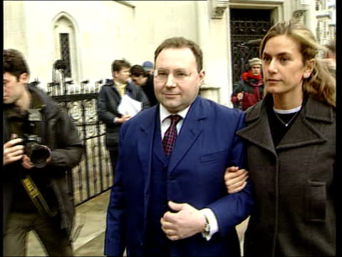 charlotte church sued by former manager; england: london: high court: ext jonathan shalit towards past arm in arm with woman as arriving at court : - charlotte church stock videos & royalty-free footage