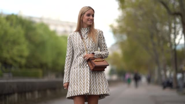 charlotte groeneveld wears a dress and a brown bag, outside valentino, during paris fashion week womenswear spring/summer 2019, on september 30, 2018... - valentino designer label stock videos & royalty-free footage