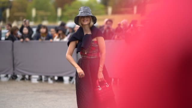 charlotte groeneveld wears a hat a pullover on the shoulders a green and red checked offshoulder top a black quilted skirt red lady dior bag black... - shoulder bag stock videos & royalty-free footage