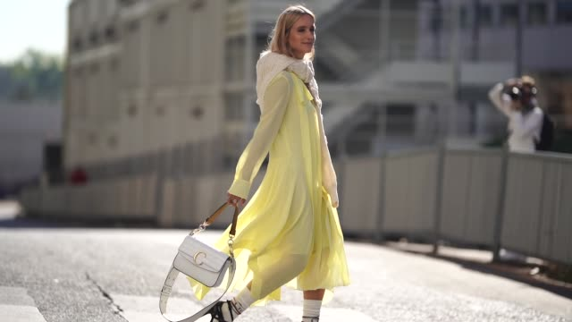 charlotte groeneveld wears a yellow dress, a white bag, outside chloe, during paris fashion week womenswear spring/summer 2019, on september 27, 2018... - street style stock videos & royalty-free footage