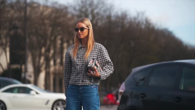 charlotte groeneveld wears sunglasses, a black and white checked tweed jacket, blue denim flared jeans, shoes, outside chanel, during paris fashion... - checked pattern stock videos & royalty-free footage