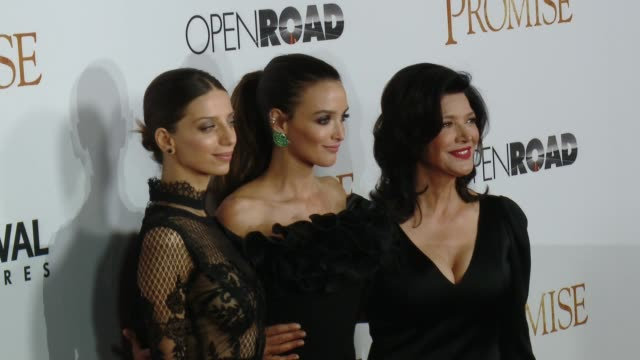 Charlotte Le Bon Angela Sarafyan and Shohreh Aghdashloo at the 'The Promise' Los Angeles Premiere at TCL Chinese Theatre on April 12 2017 in...