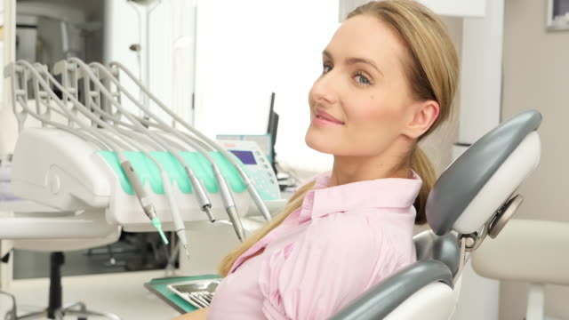 charming female patient at dentist - persona attraente video stock e b–roll