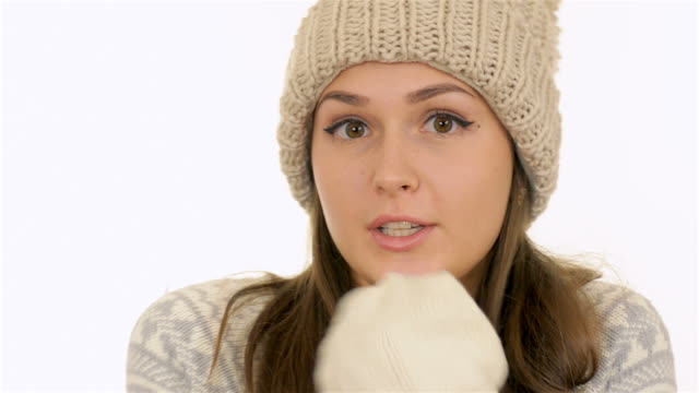 charming girl froze and blowing on his hands - mitten stock videos and b-roll footage